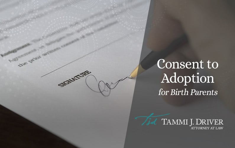 Close-up of birth parent signing adoption consent paperwork.